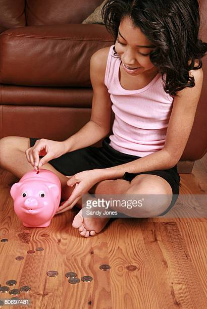10-year old child with piggy bank and change
