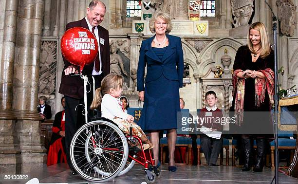 10yearold Alice Moore receives her Woman's Own Children of Courage award from Camilla Duchess of Cornwall at Westminster Abbey on December 14 2005 in...