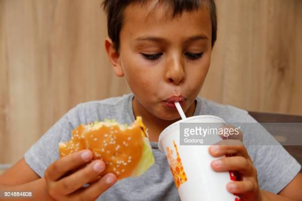 10yearold boy in a fast food restaurant France