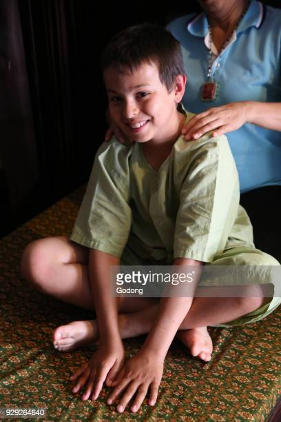 10yearold boy receiving a Thai massage Thailand