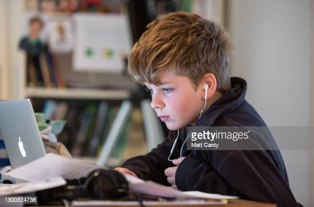 Year-old boy, the photographer's son, continues home schooling online via a laptop, on January 11, 2021 in Bath, United Kingdom. Under current...