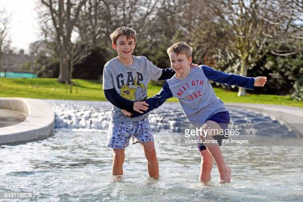 10yearold Jacob Heal and his brother Aidan splash around in the Diana Memorial Fountain in Hyde Park London during mild weather across the country