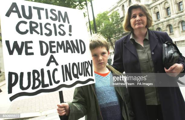 Year-old Michael Thomas, who suffers from autism and bowel disease, and his mother Isabella campaign outside Downing Street, London. *The pair, who...