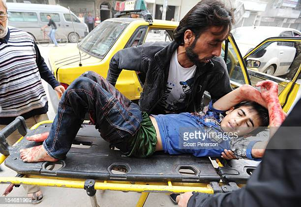 A 10yearold Syrian boy wounded by shrapnel is brought to hospital as the intense human and material cost grows from three months of intense fighting...