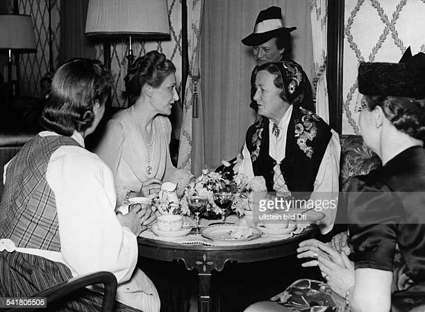 *Wife of Joseph GoebbelsInternational women's meeting in Berlin from left to right Johanna Martin Magda Goebbels Olga Bjoner in the background Mrs...