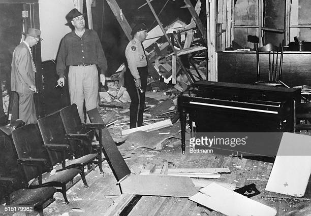 Montgomery, Alabama: Policemen and reporters inspect the damage to the shattered Bell Street Baptist Church here Jan. 10th, after the church was hit...