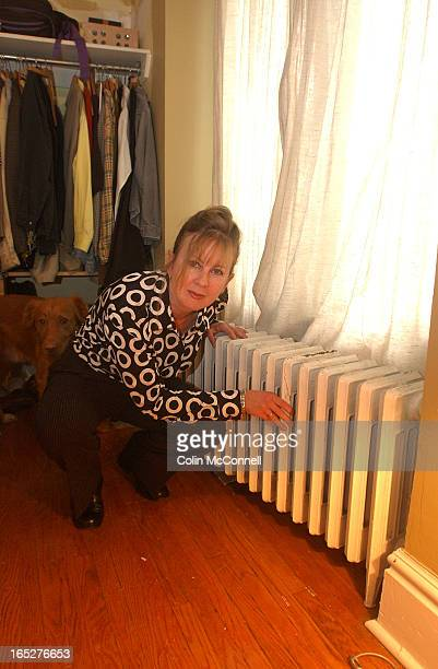 1/11/04pics of jennifer wells who is doing a story about the things in her house that are broken like a hole in the ceiling and leaking radiators...