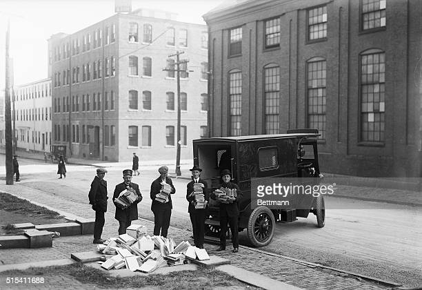 Boston MA Photo shows officers and clerks loading a police ambulance with Red literature seized at Communist headquarters in Cambridge within a...