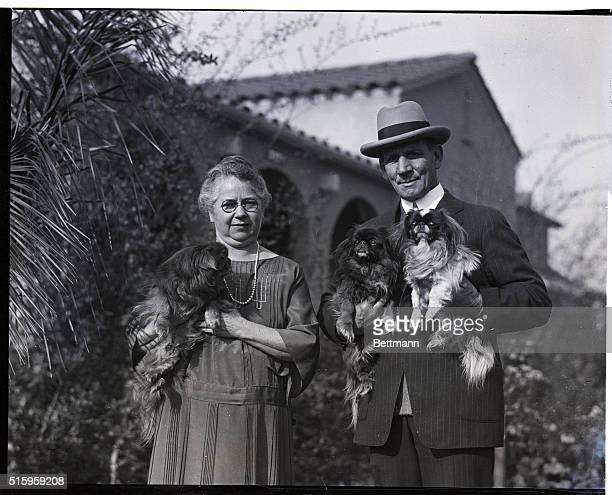 1/11/1926Culver City CaliforniaTommy Ryan and his wife of thirty years with their prize Pekinese dogs on the Palatial grounds of their Spanish...