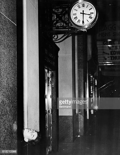New York, NY- As is true of so many Weegee photos, this one needs no caption. This fellow is sleeping in a bank window on 42nd Street, a few steps...