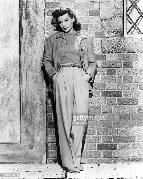 """New York, NY- For casual wear, Lilli Palmer, the European actress who appears in the U.S. Film """"Cloak and Dagger,"""" models some clothes from her..."""