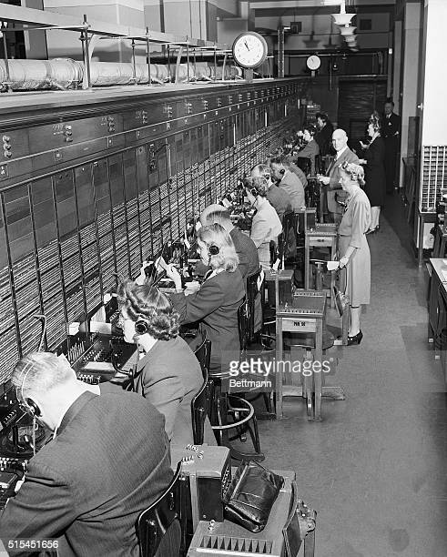 1/11/1946New York NY Supervisors and executives of the American Telephone and Telegraph Company man one of the big long distance switchboards at the...