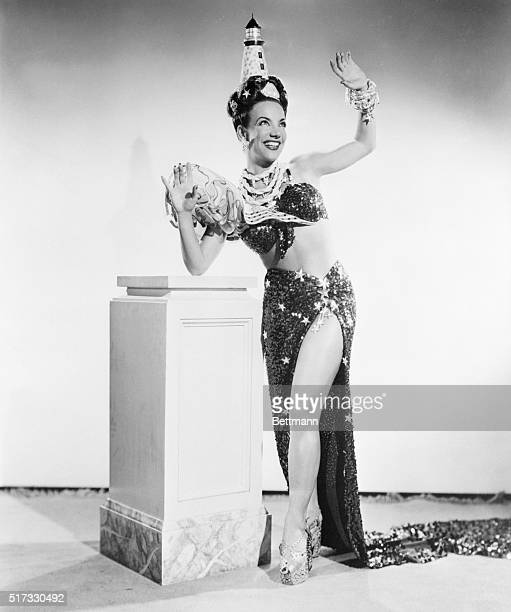 Hollywood CA Individualist Carmen Miranda she of the platformsoled shoes and second glance headgear reveals a shapely bit of her legs in her newest...