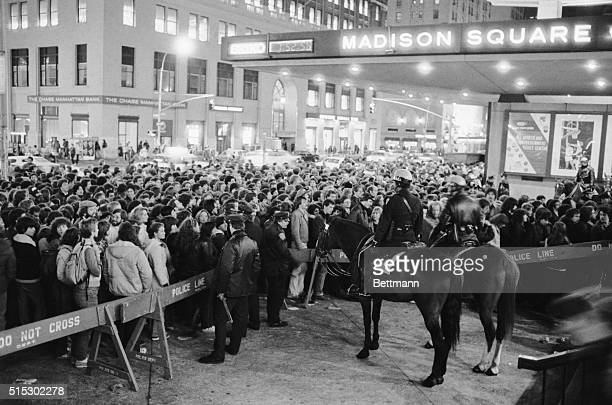 New York, New York- An orderly crowd of ticket holders for the rock group the Rolling Stones performance at Madison Square Garden file through police...