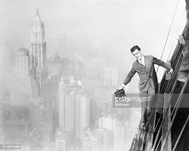 New York NY Jack Reilly intrepid photographer precariously perched from the 72 story of the world's tallest building the 74 story Bank of Manhattan...