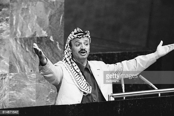 "New York, NY: Yasser Arafat throws out his arms to make a point during his address to the United Nations General Assembly. The PLO leader said, ""I..."