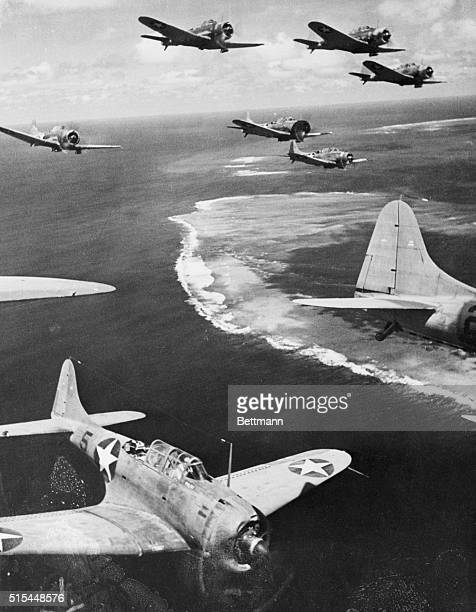 Midway Island The Pacific A group of US fighter planes rear in formation high over the reefs of Midway Island one of Uncle Sam's strategic bases in...
