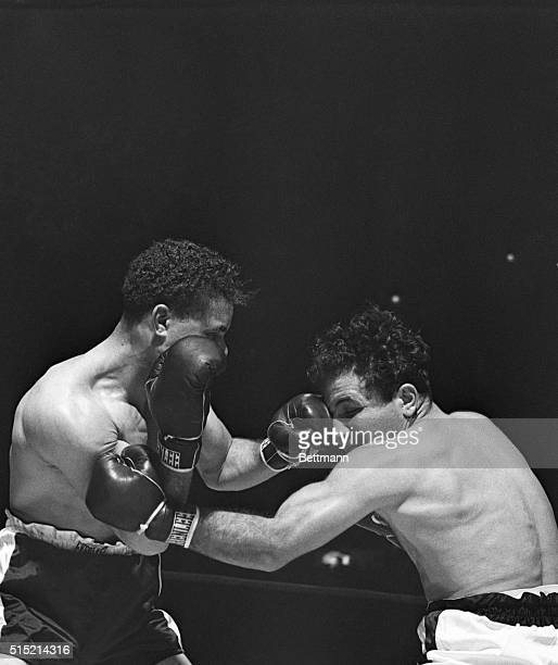 New York NY Coming in close Billy Fox lands a smashing left on the eye of Jake La Motta during their scheduled 10round bout at Madison Square Garden...