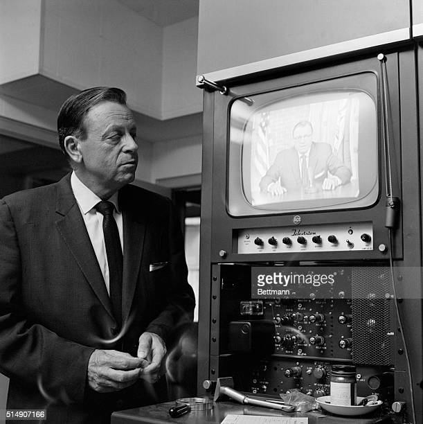 Baton Rouge LA LA Gov Jimmie H Davis watching a play back of a video taped speech that he made 11/13 on a statewide network regarding the legal...