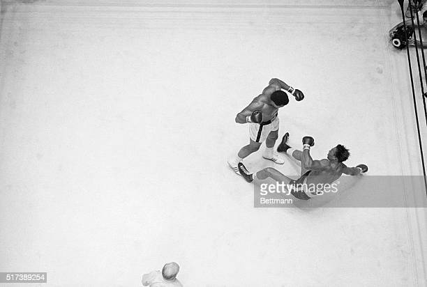 Houston TX Heavyweight champion Cassius Clay knocks challenger Cleveland Williams to the canvas in the 3rd round of title fight in Houston's Dome...