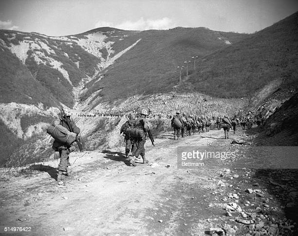 North Korea US Marines slog up a mountain road in their advance to the Changin Reservoir big source of electric power for North Korea On the hillside...