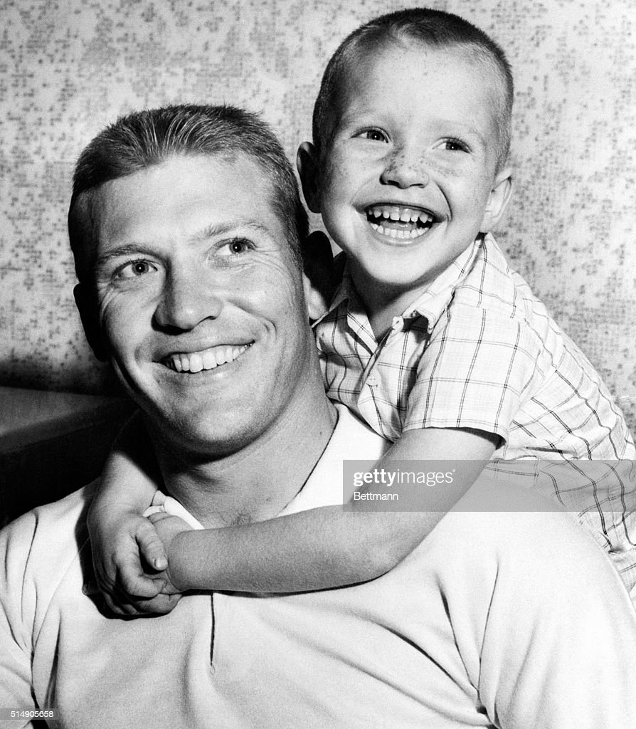 New York Yankee slugger Mickey Mantle gets a hug from his proud son, Mickey Elvin, 5, here November 15, after pop won the American League Most Valuable Player Award by a unanimous vote. Mighty Mick led the league in hitting, with a .353 average; in homers, with 52; and runs batted in, with 130, to sweep all 24 votes of the Baseball Writer's Association of America Committee.