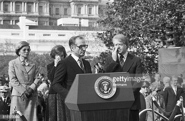 Washington, DC- President Carter and the First Lady wipe their eyes from the gas fumes that moved onto the White House grounds from an anti-Shah...