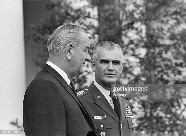 Washington, DC: President Johnson and General William C. Westmoreland walk through the White House Rose Garden Nov 16th on their way to the East...
