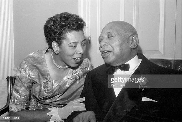 New York, NY- Tennis champion Althea Gibson combines with famed Negro blues composer W.C. Handy in a playful duet before the 84-year-old composer's...