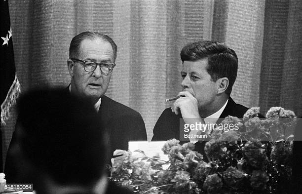 Seattle WA President John F Kennedy enjoys an afterdinner cigar here late November 16 just before he spoke at a banquet honoring Senator Warren G...