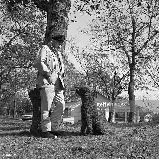 Wearing an old skipper's cap John Steinbeck enjoys a stroll with his famous french poodle 'Charley' The pooch is the 'hero' of the bestselling...