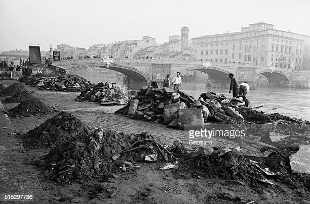 Florence Italy Floodborne debris is heaped in neat piles on the banks of the River Arno as cleanup operations go on following severe floods that...