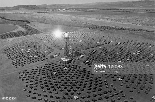Barstow CA A field of heliostats reflects the sun's rays toward Solar One's boiler atop a 300foot tower to produce superheated steam which in turn...
