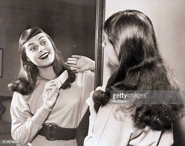 """New York, NY- Bronx coloratura Roberta Peters is shown grooming her hair at her midtown hotel today, after making a surprise debut as Zerlina in """"Don..."""