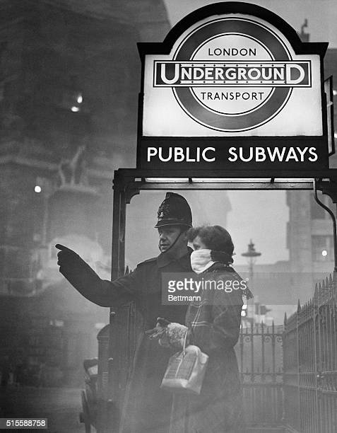 London England Forewarned is forearmed indeed as this London visitor proves She came prepared with her smog mask on a London visit A policeman is...