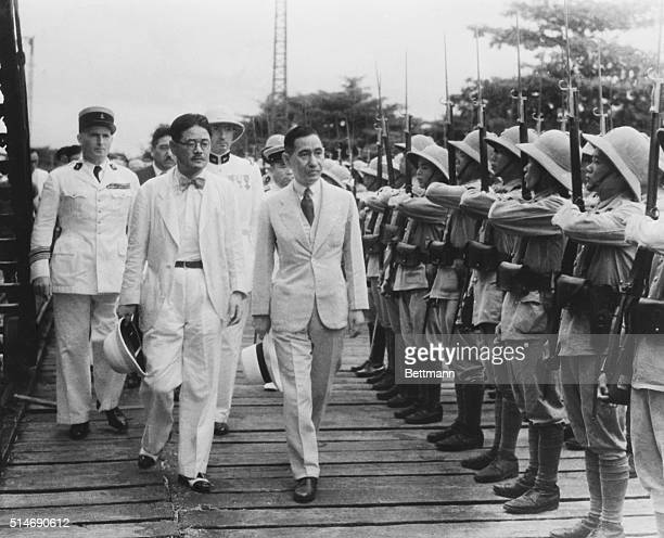 11/18/40Haiphong IndoChina Hajime Matsumiya Japan's special envoy to French IndoChina shown in company of French officials and Rokuro Suzuki Japanese...