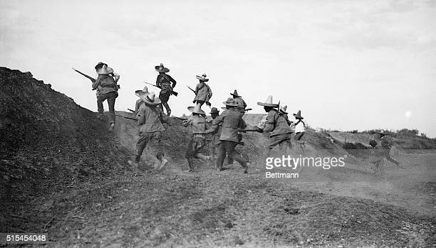 11/1913Mexican Revolution of November 1913 Photo shows Pancho Villa's troops rushing the federal lines under protection of cannon fire