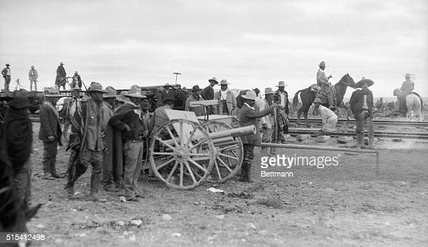 Mexican Revolution of 1913 Photo shows Pancho Villa directing the first shot from cannon