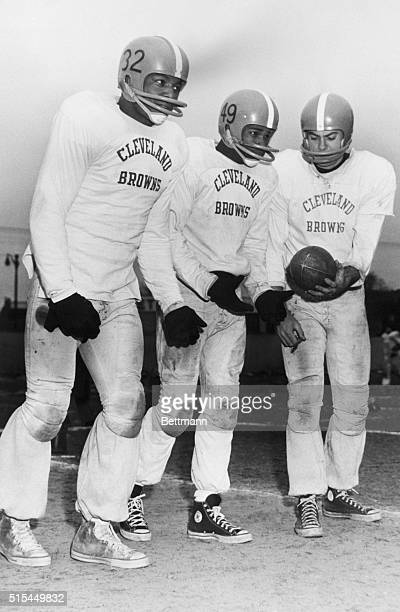 Cleveland Ohio Cold weather brought out gloves for these two top running stars of the Cleveland Browns Jim Brown and Bobby Mitchell Handing the ball...
