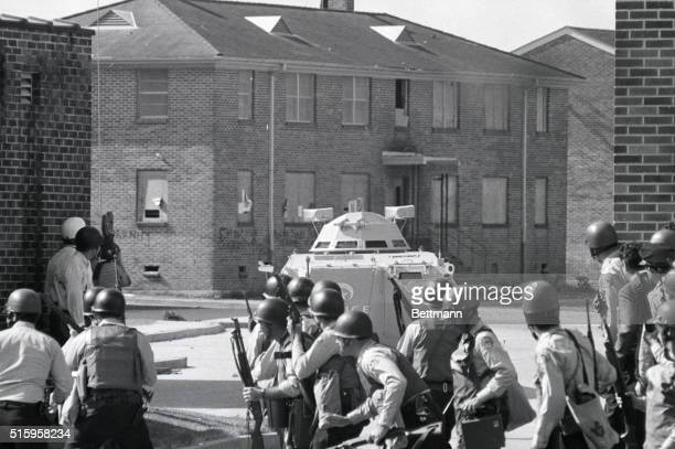New Orleans LA Helmeted police wearing armored vests and carrying automatic rifles and carbines dash across a driveway at the Desire Housing Project...