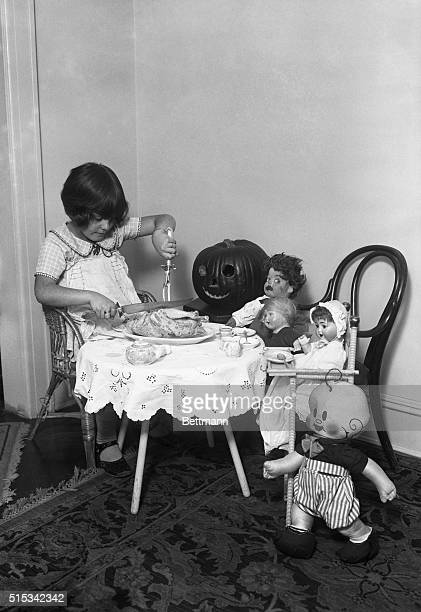 Marilyn Miller of Long Beach NY practices up for Thanksgiving dinner by having one of her own with her dolls
