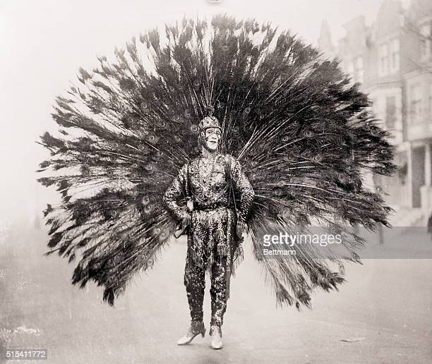 1/1/1926Philadelphia PA AND THEN HOW HE STRUTTED Wearing this gorgeous peacock costume Francis Patameda of Philadelphia was one of the striking...
