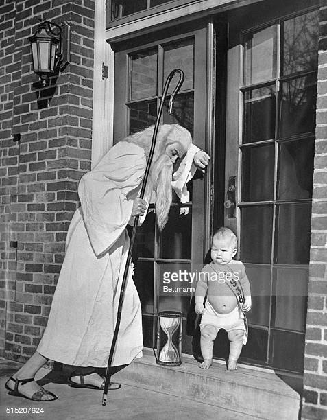 1/1/1938Photo shows elderly Father Time the Baby New Year and an hourglass