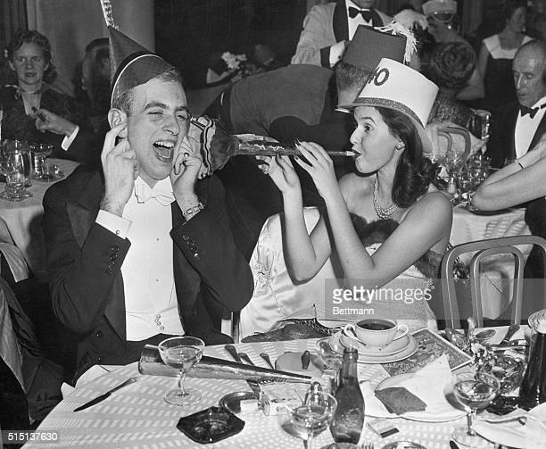 New York, New York- William Van Nostrand and Josephine Johnson, whoop it up as they celebrate the arrival of the New Year in the Sert Room of the...