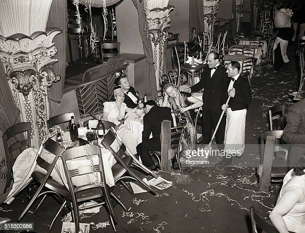 New York, NY-: Employees of Bily Roses Diamond Horseshoe are shown trying to rouse a party of drowsy merry makers in order to proceed with thier...