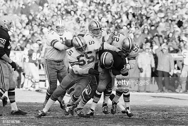 1/1/1968Green Bay WI Green Bay quarterback Bart Starr is treated roughly as he is thrown for a seven yard loss by the Cowboy defense Green Bay won...