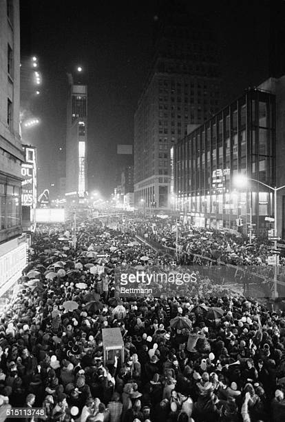1/1/1975New York New YorkORIGINAL CAPTION READS Thousands of joyous New Year's Eve revelers crowd the Times Square area to watch the 86foot descent...