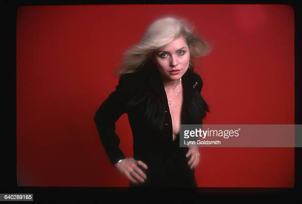 11/1978Closeup of Deborah Harry posed in a vneck dress with her hands on her hips