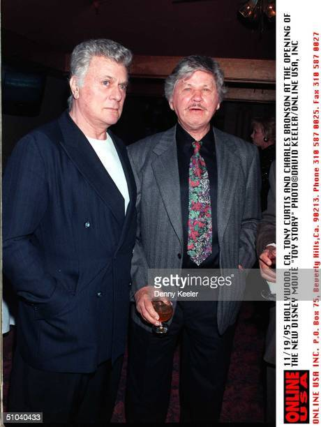 95Charles Bronson And Tony Curtis At The Premiere Of Disney's Movie Toy Story