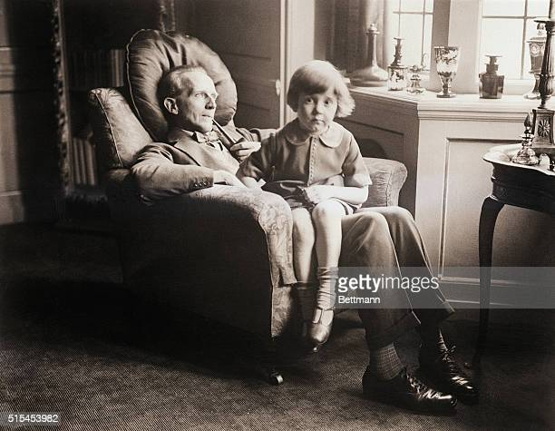 This charming photo shows MrAAMilne the famous British dramatist author of 'MrPim Passes By' and others with his no less famous son Christopher Robin...